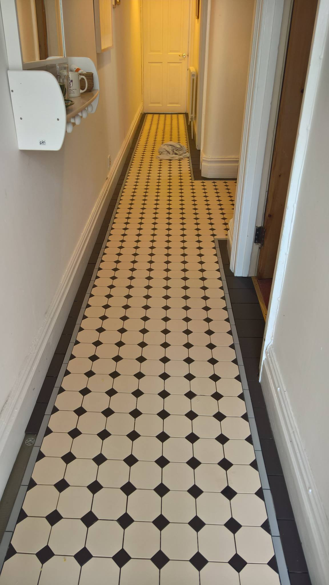photos of a victorian floor installation by bishopston tiles