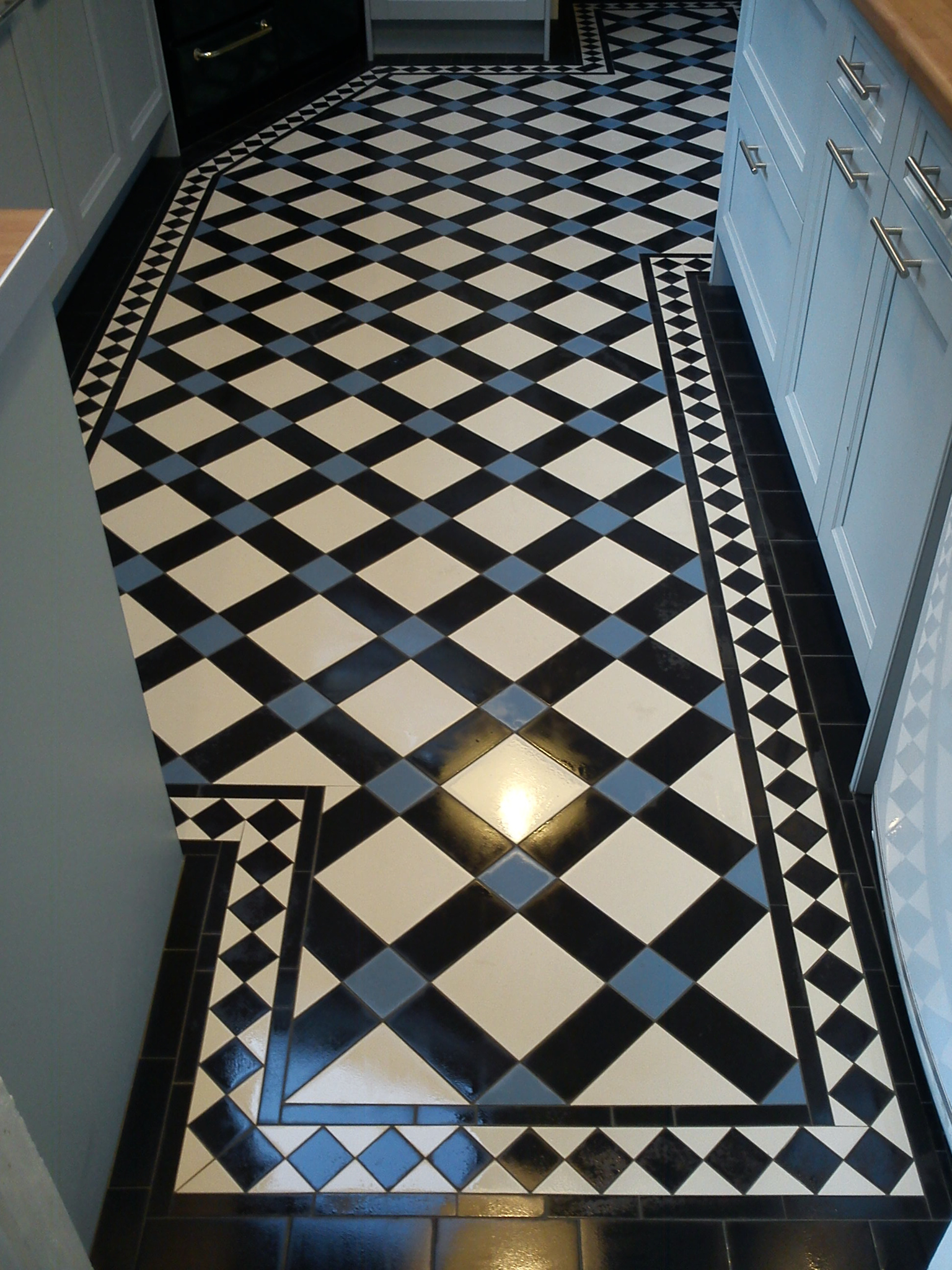 Victorian tiles for floors and walls in our Bristol showroom. on victorian hallways, victorian furniture, victorian living room, victorian walls, kitchens with grey floors, victorian style kitchens, victorian style bedroom, victorian dining room, victorian kitchens for today, wood floors, kitchens with terracotta floors,